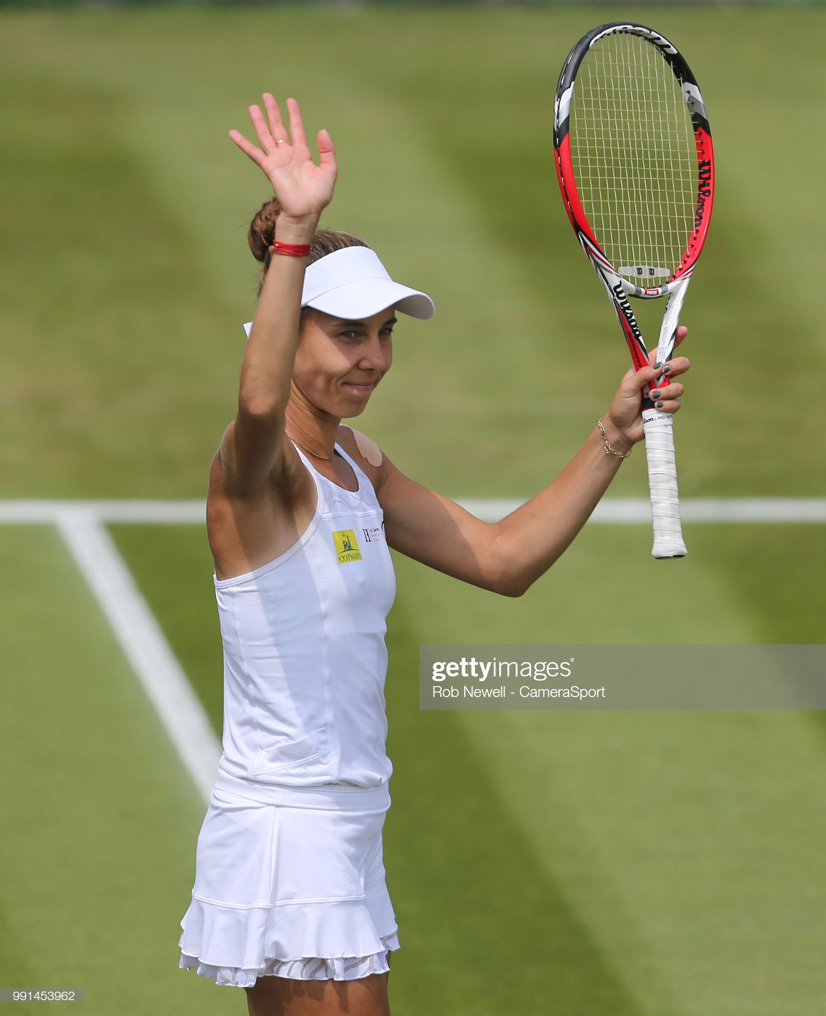 LONDON, ENGLAND - JULY 04:   Mihaela Buzarnescu (ROU) acknowledges the crowd after winning her match against Katie Swan (GBR) at All England Lawn Tennis and Croquet Club on July 4, 2018 in London, England. (Photo by Rob Newell - CameraSport via Getty Images)