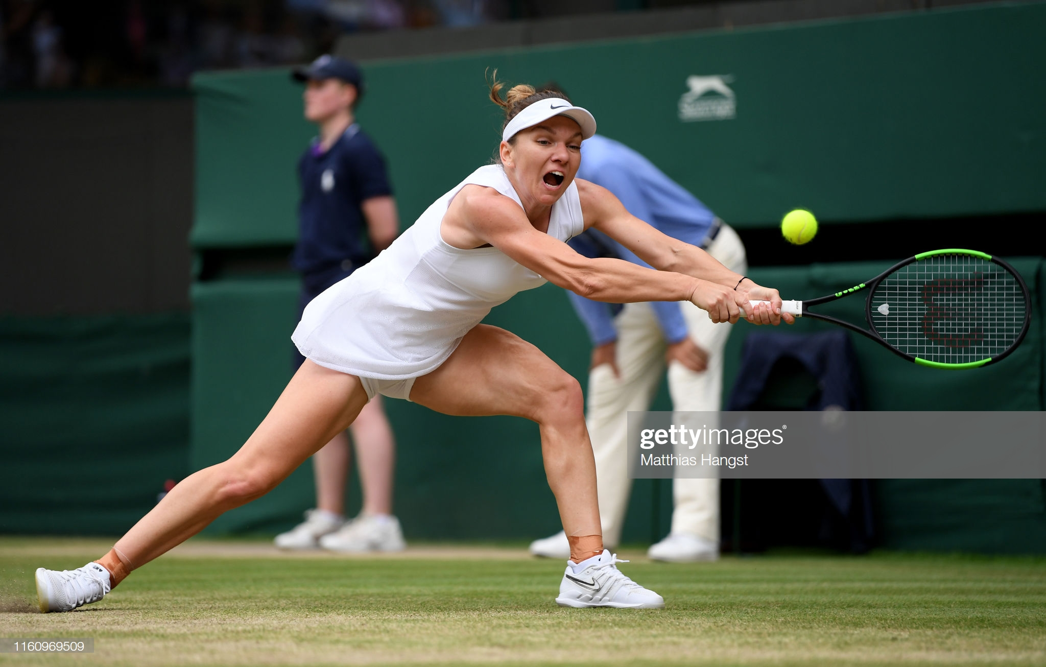 LONDON, ENGLAND - JULY 09: Simona Halep of Romania plays a backhand in her Ladies' Singles Quarter Final match against Shuai Zhang of China during Day Eight of The Championships - Wimbledon 2019 at All England Lawn Tennis and Croquet Club on July 09, 2019 in London, England. (Photo by Matthias Hangst/Getty Images)