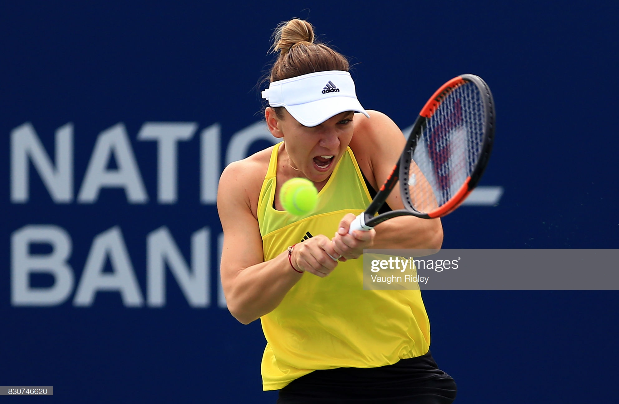 TORONTO, ON - AUGUST 12: Simona Halep of Romania plays a shot against Caroline Garcia of France during a quarterfinal match on Day 8 of the Rogers Cup at Aviva Centre on August 12, 2017 in Toronto, Canada. (Photo by Vaughn Ridley/Getty Images)
