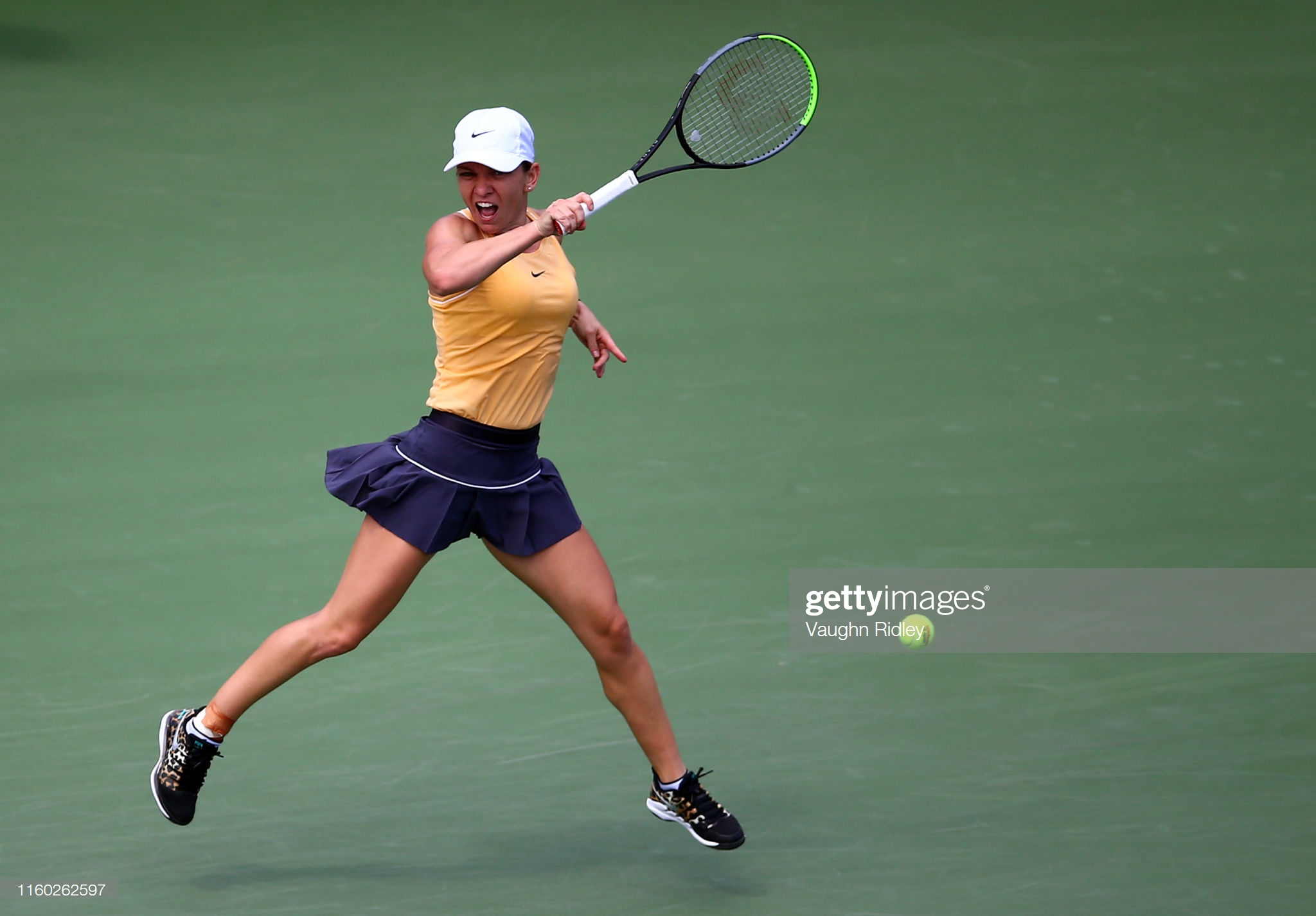 TORONTO, ON - AUGUST 07: Simona Halep of Romania hits a shot against Jennifer Brady of the United States during a second round match on Day 5 of the Rogers Cup at Aviva Centre on August 07, 2019 in Toronto, Canada. (Photo by Vaughn Ridley/Getty Images)