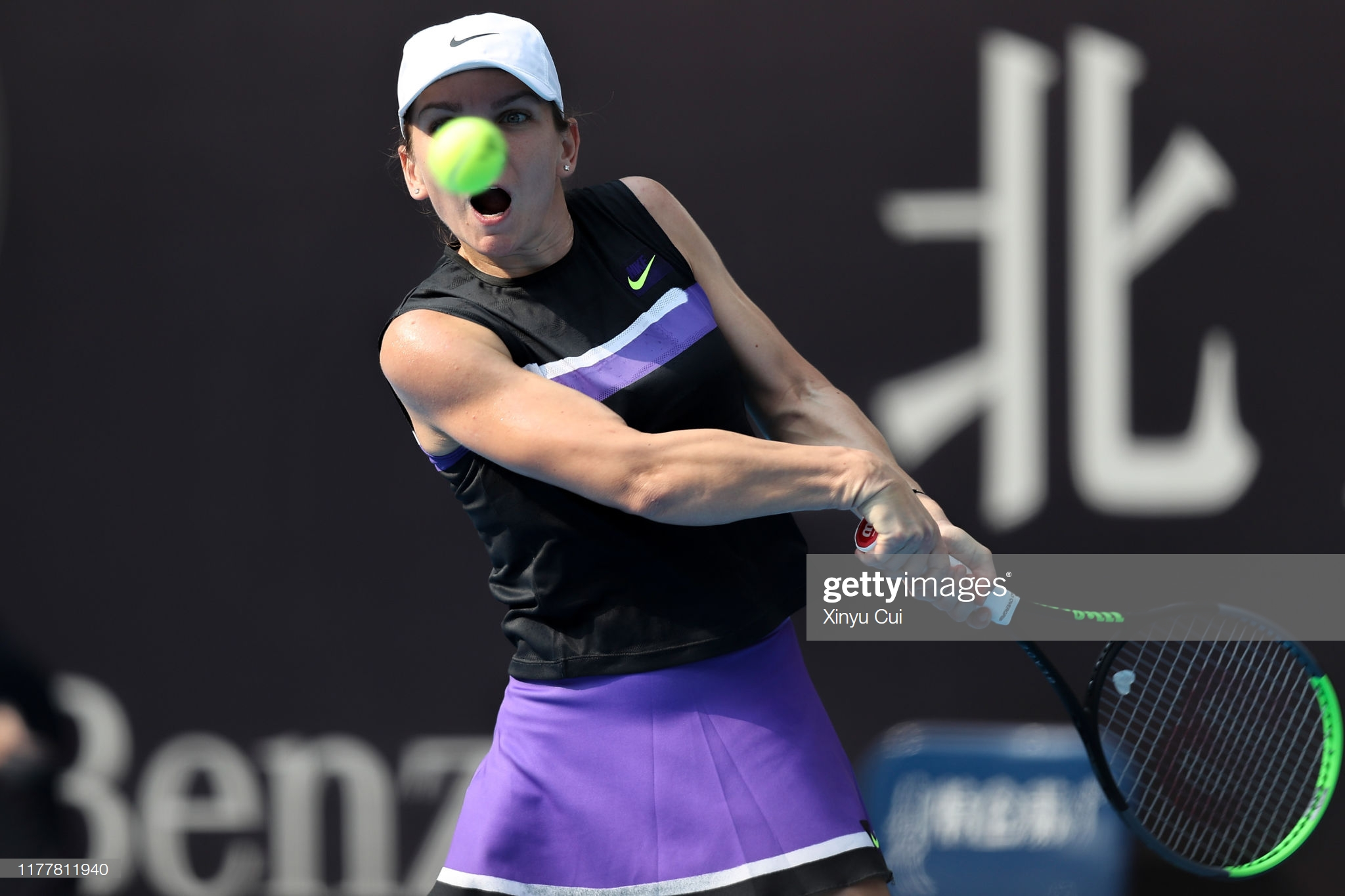 BEIJING, CHINA - SEPTEMBER 29: Simona Halep of Romania returns a shot against Rebecca Peterson of Sweden during women's singles first round match of 2019 China Open at the China National Tennis Center on September 29, 2019 in Beijing, China.  (Photo by Xinyu Cui/Getty Images)